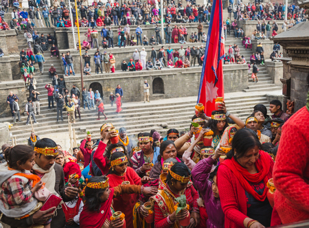 Kathmandu,Nepal - Feb 12,2018: Hindu devotees with bare foot and holy water pots returning back  after offering Holy Water to Lord Shiva. This is on the occasion of Bol Bom and Mahashivaratri Festival at Pashupatinath Temple,Aryaghat. Editorial