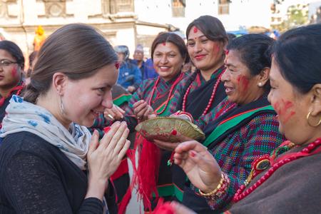 Kathmandu,Nepal - May  01,2017: A Tourist with Nepali women in Patan Kathmandu during Rato Machindranath Jatra Festival. Editorial