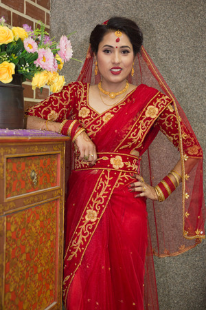 Beautiful Nepali Bride with wedding dress and make up at the wedding ceremony in Nepal. Editorial