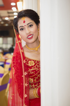 Beautiful Nepali Bride with wedding dress and make up at the wedding ceremony in Nepal. Sajtókép