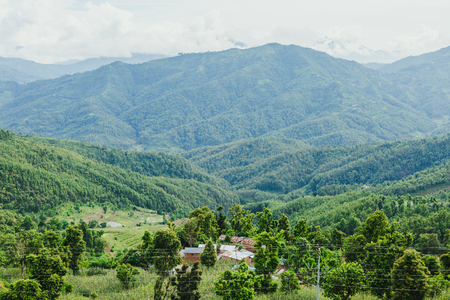 Scenery of beautiful Nepali rural village with mountains  and green forest.It is in the hilly region of Gorkha Nepal.Breathtaking view,Dramatic and picturesque scene. Popular tourist attraction destinations. Stock Photo