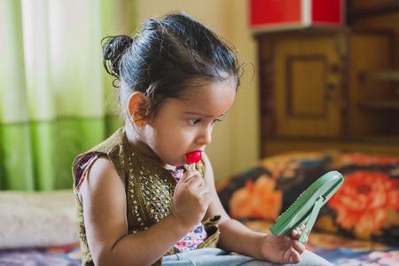 Happy Asian baby boy having fun with eating lollipop.Children having lollipop 写真素材