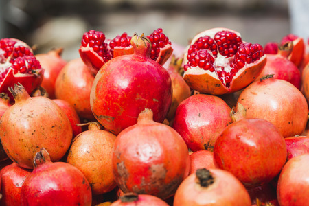 Pomegranate fruits and seeds kept for sale in the street of asian market. Banco de Imagens