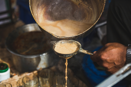 Making Masala milk tea for sale in the street of kathmandu Nepal.Street Food for sale.