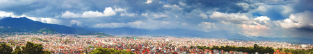 Panoroma aerial view of kathmandu city with himalayas,City of temples kathmanddu view from Bagh Bbhairab temple,Kritipur.