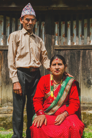 Gorkha,Nepal - Sep 30,2017: A Beautiful Nepali Old Couple posing for a photograph in the rural village of Nepal. Editorial