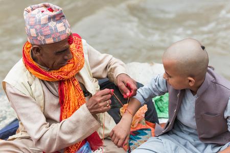 Kathmandu,Nepal - Aug 26,2018:People Celebrating Janai Purnima or Raksha Bandhan at Pashupatinath,Kathmandu Nepal. Editorial