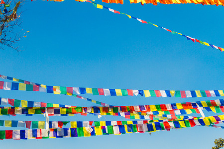 Colorful Prayer Flags with blue sky background Archivio Fotografico