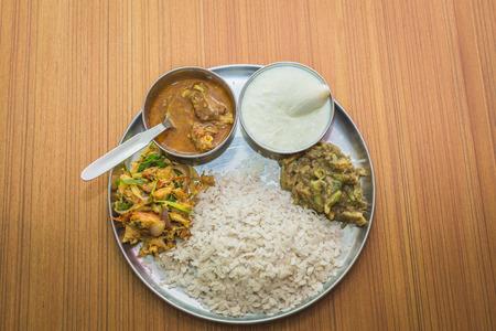 Nepali Style snacks or Khaja Set on the plate with meat,curd,pickle,beaten rice etc. Teej Dar Snacks Set of Nepali Women.