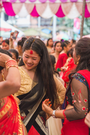 Kathmandu,Nepal - Sep 12,2018: Nepali Hindu Women Dancing at Teej Festival in Kathmandu.Hindu Nepali Women fast and wish for a prosperous life of their spouse and family on this festival.The festivals for women, include dancing, singing, getting together