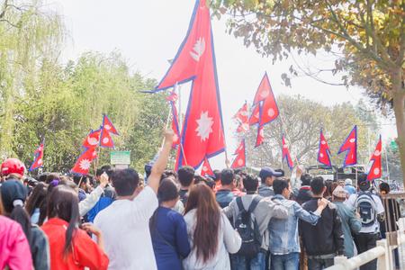 kathmandu,Nepal - Mar 10,2018: People at rally with Nepalese flags in Kathmandu.Protesters Editorial