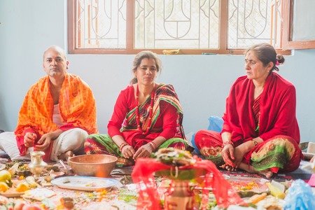 kathmandu,Nepal - Mar 10,2018: A Hindu Family Worshiping god at home according to hindu rituals in Kathmandu. Hindu Prayers.