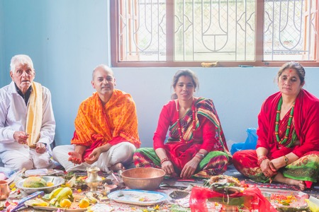 kathmandu,Nepal - Mar 10,2018: A Hindu Family Worshiping god at home according to hindu rituals in Kathmandu. Hindu Prayers.