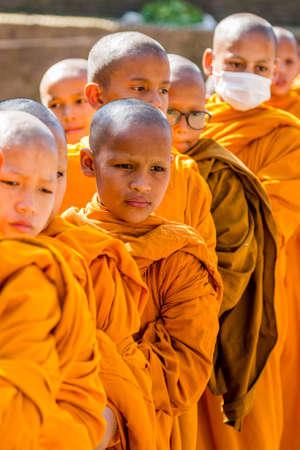 Kathmandu, Nepal - October 27, 2018 : Little Buddhist Monks in Boudhanath Stupa Kathmandu during Buddha Jayanti Festival. Cute Little Monks