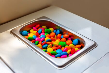 Colorful Candy in Ice Cream Counter.Chocolate Candy Background