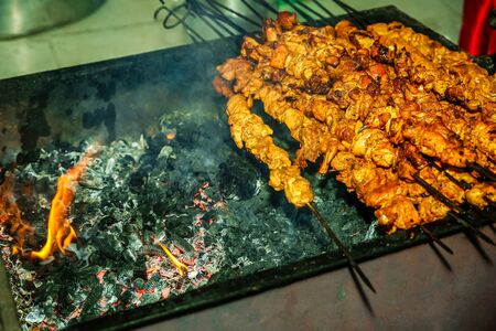Chicken Sekuwa, Grilled chicken meat on charcoal with skewers