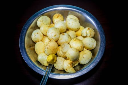 Many Boiled Eggs Mixed with Salt and other ingredients. Newari Food Nepal