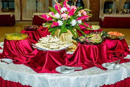 Assorted Salads on the Table,Banquet Buffet Salads Table.Cold appetizers and vegetables salads.Catering Food.Selective Foucs