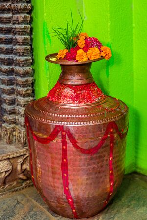 Mangal kalash at door with Sacred colors and Flowers, Hindu Rituals. Celebration