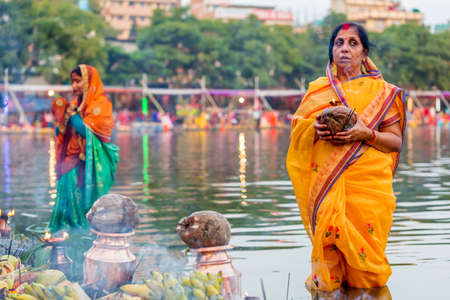 Kathmandu,Nepal - November 1,2019: Hindu devotees offering prayers to sun god standing in water according to hindu rituals during Chhath Puja Festival in Kathmandu. Chath Puja rituals Editorial