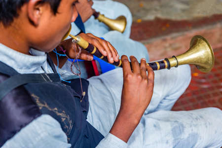 kathmandu,Nepal - July 9, 2019: Traditional Flute player playing music at wedding ceremony in kathmandu. Selective Focus