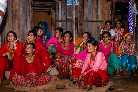 Gorkha,Nepal - June 25,2019: Nepali Women with traditional attire during wedding ceremony in rural village of Nepal.