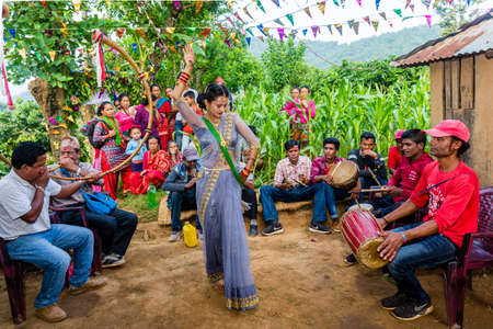 Kathmandu,Nepal - June 25,2019: Nepali People enjoying with local music and dance during wedding ceremony in rural village of Nepal. Editorial