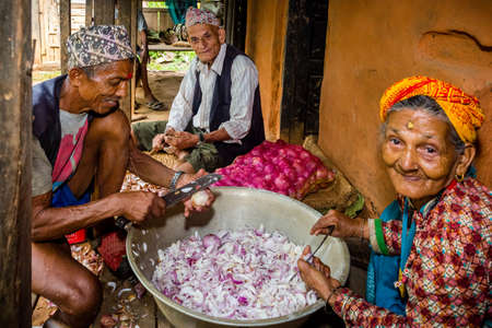 Gorkha,Nepal - June 26,2019: Old Nepali Village People working together during wedding ceremony in rural village of Nepal.