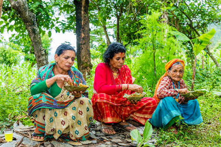 Gorkha,Nepal - June 26,2019: Nepali Women with traditional attire in rural village of Nepal.