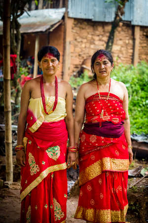 Gorkha,Nepal - June 26,2019: Nepali Brahmin Women in traditional attire to cook food at wedding ceremony in rural village of Nepal.