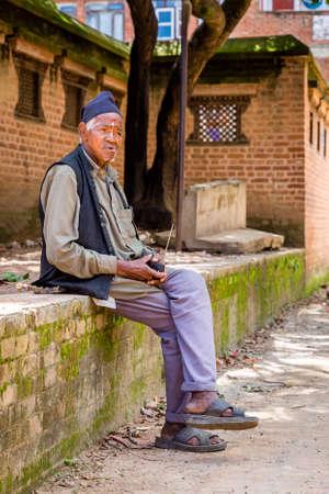 Kathmandu,Nepal - August 2,2019: Nepali old Man Listening to Radio in the village of Nepal.