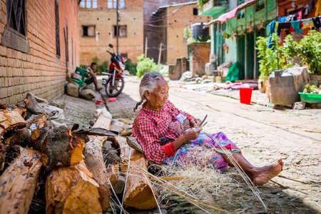 Kathmandu,Nepal - August 2,2019: Old Nepali Woman busy at her work in bhaktapur Nepal.