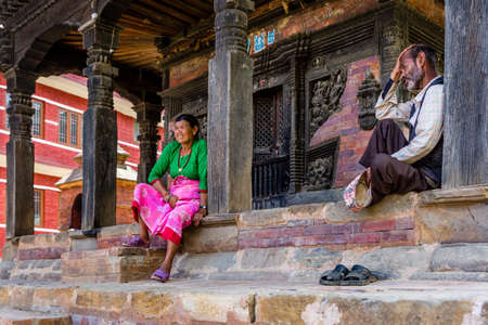 Bhaktapur,Nepal - August 2,2019: Nepali People enjoying leisure time with sitting in Bhaktapur durbar square.