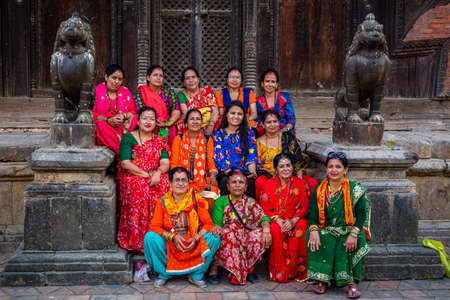 Kathmandu,Nepal - August 2,2019: Group of Nepali Hindu Women posing for photograph in the Temple of Kathmandu. Editorial