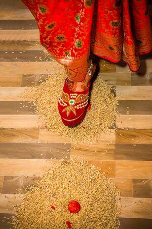 Hindu Marriage Wedding Ceremony,Nepali Wedding Rituals, Griha Prabesh,Bride entering groom's house Standard-Bild - 148388823