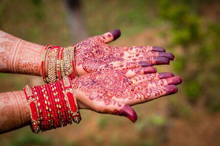 Beautiful Hindu Bride's Hand with Henna Mehendi and Bangles