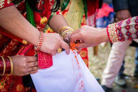 The groom applies sindoor or vermilion to the bride as a symbol of marriage according to Hindu rituals. Hindu Marriage Wedding Ceremony,Nepali Wedding Standard-Bild - 148388880