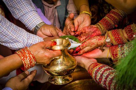 Details of Hindu marriage wedding ceremony.Hindu wedding Rituals.Focus on bride and groom's hand