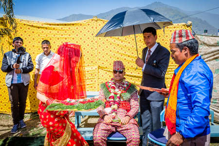 Kathmandu,Nepal - March 13,2019 : Bride welcoming Groom during wedding day ceremony.Details of Hindu marriage wedding ceremony.Hindu wedding Rituals