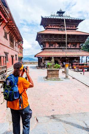 Kathmandu,Nepal - August 15,2019: Tourist Taking a photo at Bagh Bhairav Temple Kathmandu Nepal.Tourist Travel Destination in Kathmandu.Places to visit in Kathmandu. Selective Focus on Man Editorial