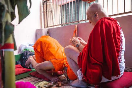 Kathmandu,Nepal - June 11,2019: Hindu Holy Boy learning Religious Gayatri Mantra from his Grandfather during religioius ceremony Bratabandha in Kathmandu.Hindu People