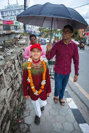 kathmandu,Nepal - June July 6,2019: Hindu Boy returning home from Temple with his maternal uncle during religioius ceremony Bratabandha in Kathmandu.Hindu People. Standard-Bild - 149030206