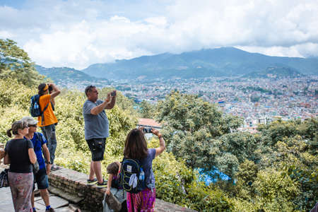 Kathmandu,Nepal - August 15,2019: Many Tourists taking photographs of Kathmandu Valley from Bagh Bhairav Temple in Kritipur.Tourist Travel Destinations In Nepal. Standard-Bild - 149030208