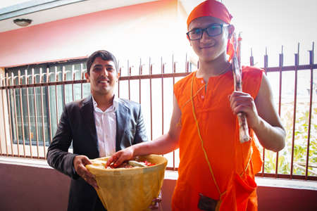 Kathmandu,Nepal - June 11,2019: Hindu Holy boy with his maternal uncle during religious ceremony Bratabandha in Kathmandu.Hindu People,Hindu rituals Hindu rituals Standard-Bild - 149030216