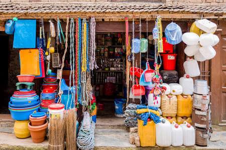 Kathmandu,Nepal - August 2,2019: Consumer goods for sale at the shop in Kathmandu.Plastic pots shop.Nepali Shopkeeper Editorial