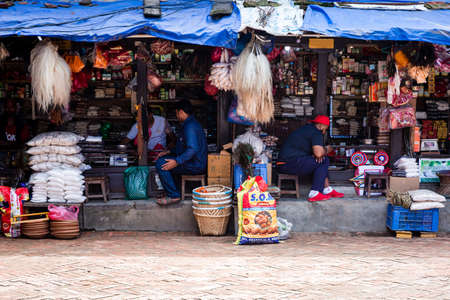 Kathmandu,Nepal - August 16,2019 : Consumer goods for sale at the shop near patan durbar square in kathmandu. Nepali Shopkeeper