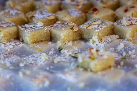 Fresh Indian sweets mithai from India prepared with milk,sugar and other ingredents. Burfi Sweet Dish Standard-Bild - 149614802