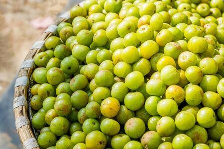 Fresh Gooseberry or Amala kept for sale in the street market Standard-Bild