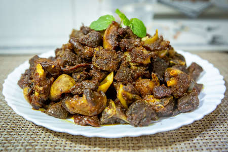 Delicious Indian Nepali Style Mutton Fry, dry fry meat,Dashain Special Mutton Fry Recipe.Selective focus photograph.
