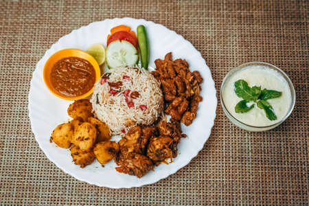 Varieties of Nepali food served together on the plate with sweet yogurt. Teej ko Dar, Teej Special food platter ,Nepalese Cuisine, Rice pulao Standard-Bild